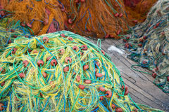 Colorful fishing nets in pile Stock Image