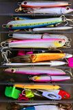 Colorful fishing saltwater fish lures box. Colorful fishing saltwater fish lures in a box, rusted hooks Royalty Free Stock Image