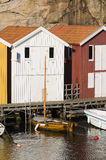 Colorful fishing sheds and wooden boat Stock Image
