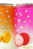 Colorful fizzy drink cans with water droplets Stock Images