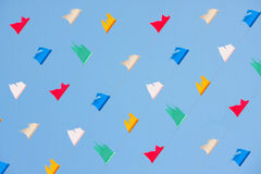 Colorful flag celebrities symbol. Colorful flick flag on blue sky, celebrities symbol Royalty Free Stock Photos