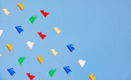 Colorful flag of celebrities symbol. Colorful flick flag on blue sky, celebrities symbol Royalty Free Stock Image