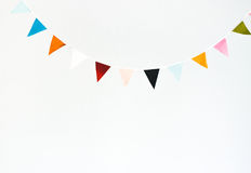 Colorful flag garland. Isolated on white. Holidays, birthday concept Stock Images