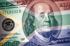 Flag of south africa on a american dollar money background stock photos