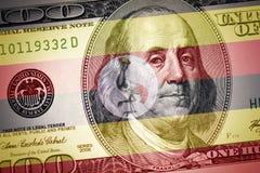 Flag of uganda on a american dollar money background stock photo