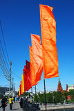 Colorful flags wave on the Moscow river embankment Royalty Free Stock Photos