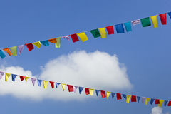Colorful flags in the air Stock Image