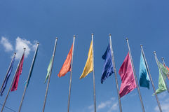 Colorful flags. On a blue sky Royalty Free Stock Photos