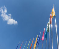 Colorful flags. On a blue sky Royalty Free Stock Images