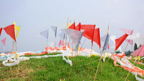 Colorful flags on chinese grave Royalty Free Stock Photography