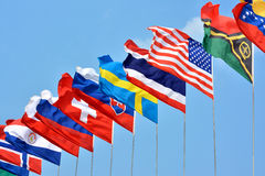 Colorful flags from different countries. Different countries national flags getting together under blue sky, shown as worldwide, country, and international Stock Images