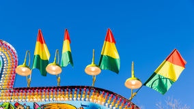 Colorful flags and lights at an amusement park Stock Images