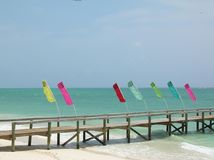 Colorful Flags on a Lonely Pier Royalty Free Stock Photo