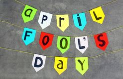 Colorful flags with phrase. `April fool`s day` on grey background Stock Photo