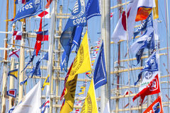 Colorful flags of sailing ships. Stock Photos