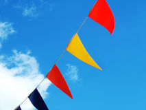 Colorful flags in the sky Royalty Free Stock Image