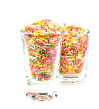 Colorful flake topping isolated on white background. Closeup of Colorful flake topping in glasses isolated on white background Stock Photography