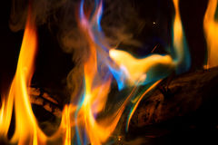 Colorful Flames. In a fireplace.  Minerals thrown on fire made blue and turquoise flames Royalty Free Stock Image