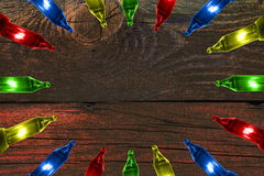 Colorful flashing lights on color wooden background with copy space Royalty Free Stock Photography