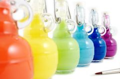 Colorful flasks and brush. Clean brush is ready to be your tool Royalty Free Stock Photography