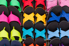 Colorful of flat shoes hanging on shelf for sale. Royalty Free Stock Photos