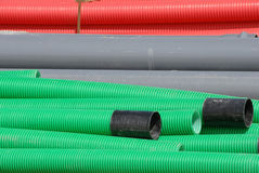 Colorful flexible pipes in construction site Stock Photos