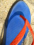 colorful-flip-flop-on-sand Royalty Free Stock Image
