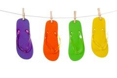 Colorful flip-flop sandles on a Clothesline stock photos