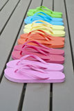 Colorful Flip Flops on the Deck Stock Photography