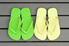 Colorful Flip Flops on the Deck Stock Images