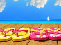 Colorful Flip Flops on Dock royalty free stock images