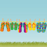 Colorful flip-flops on a rope. Stock Photos