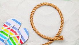 Colorful flip flops and rope Royalty Free Stock Photo
