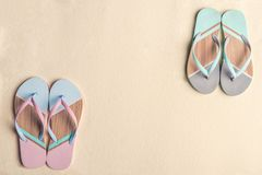 Colorful flip flops. On sandy beach royalty free stock images