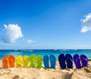 Colorful flip flops on the sandy beach. In Hawaii, Kauai Royalty Free Stock Photography