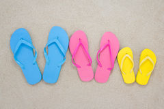 Colorful flip flops on sandy beach Royalty Free Stock Images