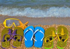 Colorful flip flops, starfish and underwater mask. Royalty Free Stock Images