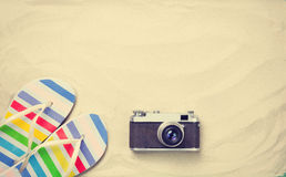Colorful flip flops and vintage camera Royalty Free Stock Images