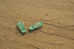 Colorful flip flops on white sand beach Stock Photography