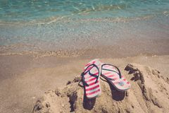 Colorful flipflop pair on sea beach. Concept of vacantion. Colorful flipflop pair on sea beach. Concept of vacantion stock photos