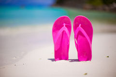 Colorful flipflop pair on sea beach Royalty Free Stock Photography