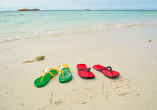 Colorful flipflop sandals. On sea beach stock photo