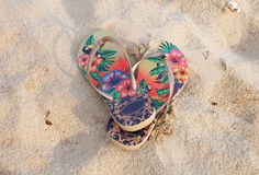 Colorful flipflop on the white sand beach. Summer day royalty free stock image