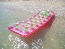 Colorful floating air mattress Royalty Free Stock Photography