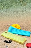 Colorful floating beds with beach items in beach Royalty Free Stock Photography