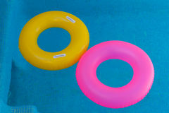 Colorful floats on a pool with crystal clear water Royalty Free Stock Image