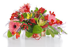 Colorful floral arrangement from lilies, cloves and orchids in c Stock Image