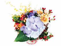 Colorful floral arrangement of roses, lilies, freesia, orchids Stock Image