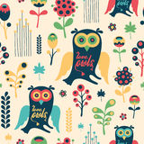 Colorful floral seamless pattern with love owls. Stock Images