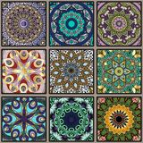 Colorful floral seamless pattern from squares. With mandala in patchwork boho chic style, in portuguese and moroccan motif Stock Photos